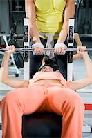 sweaty woman - health club: girl in a gym doing weight lifting  Stock Photo - Royalty-Freenull, Code: 400-04466330