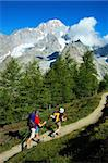 Trekkers walking along a mountain path, in background the Mont Blanc peak, west Alps, Italy. Stock Photo - Royalty-Free, Artist: rcaucino                      , Code: 400-04466839