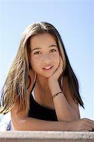 Asian teen girl against the sky Stock Photo - Royalty-Freenull, Code: 400-04469315