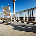 Rocking chair on porch with railing overlooking beach at Bald Head Island, North Carolina. Stock Photo - Royalty-Free, Artist: iofoto                        , Code: 400-04475169