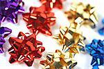 varied colored bows lined up in a row with shallow depth of field Stock Photo - Royalty-Free, Artist: vbrownjd                      , Code: 400-04475549