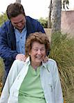 A lovely senior woman enjoying a back massage in the garden. Stock Photo - Royalty-Free, Artist: lisafx                        , Code: 400-04483973