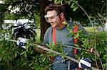 A worker in safety gear clearing hurrican debris and branches. Stock Photo - Royalty-Free, Artist: lisafx                        , Code: 400-04485292