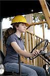 A female construction worker driving heavy equipment.  Vertical view. Stock Photo - Royalty-Free, Artist: lisafx                        , Code: 400-04485405