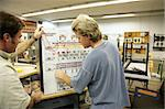 An adult education student learning about transformers.  Focus on the Transformer Trainer Board. Stock Photo - Royalty-Free, Artist: lisafx                        , Code: 400-04485417