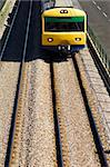 Oncoming suburban train on railway tracks. Stock Photo - Royalty-Free, Artist: mrfotos                       , Code: 400-04485458