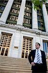 Young Attorney in Front of Courthouse - Twenties Stock Photo - Royalty-Free, Artist: surpasspro                    , Code: 400-04485719