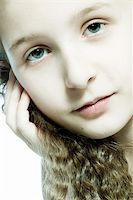 Studio portrait of a young girl feeling pretty Stock Photo - Royalty-Freenull, Code: 400-04486486
