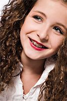 Studio portrait of a young girl with braces Stock Photo - Royalty-Freenull, Code: 400-04486498