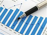 Pen showing a diagram on a report Stock Photo - Royalty-Free, Artist: pjcross                       , Code: 400-04489384