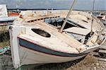An old boat resting on the sand of a small port Stock Photo - Royalty-Free, Artist: alexandr6868                  , Code: 400-04495977