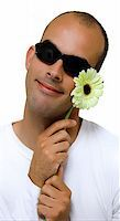 Man with a beautiful yellow flower Stock Photo - Royalty-Freenull, Code: 400-04496286