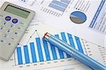 Business Background: Financial report, pen and Calculator Stock Photo - Royalty-Free, Artist: pjcross                       , Code: 400-04497334