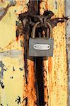 padlock hanging on rusty metal door Stock Photo - Royalty-Free, Artist: allx                          , Code: 400-04500188