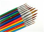 Some colored paintbrushes on a white background