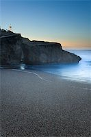 Beach of Anglet getting dark with the beacon of Biarritz to the bottom Stock Photo - Royalty-Freenull, Code: 400-04502393