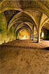 Vaulted ceilings in Fountains Abbey in North Yorkshire, shot with natural lighting from Tripod with 10-20mm lens. Old broken down abbey and surounding grounds. Ancient Gothic arches Stock Photo - Royalty-Free, Artist: pdtnc                         , Code: 400-04503191