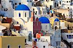 Image shows the village of Oia by day, on the beautiful island of Santorini, Greece
