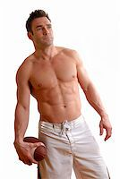topless man with a football in his hand Stock Photo - Royalty-Freenull, Code: 400-04511496
