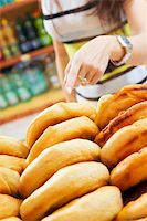 fat italian woman - customer in a supermarket buying a slice of pizza Stock Photo - Royalty-Freenull, Code: 400-04517025