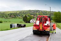 A tow truck arrives on the scene of an accident Stock Photo - Royalty-Freenull, Code: 400-04520261