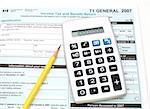 calculator and pencil over a  canadian general tax return form Stock Photo - Royalty-Free, Artist: marcusarm                     , Code: 400-04523057