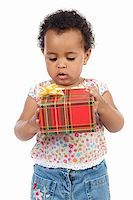silver box - Baby with a gift box a ver white background Stock Photo - Royalty-Free, Artist: Gelpi, Code: 400-04524192