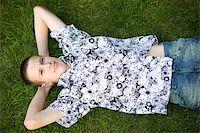 happy boy lying on grass Stock Photo - Royalty-Free, Artist: netris, Code: 400-04527768