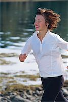 sweaty woman - Young woman running along water's edge Stock Photo - Royalty-Freenull, Code: 400-04535452