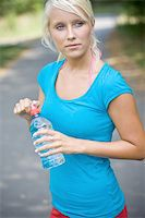sweaty woman - cool water after the long run Stock Photo - Royalty-Freenull, Code: 400-04535936