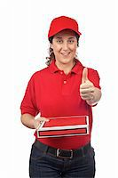 fat italian woman - A pizza delivery woman holding a hot pizza. Isolated on white and success gesture. Focus at front Stock Photo - Royalty-Freenull, Code: 400-04535956