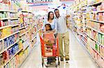 Young family grocery shopping in supermarket Stock Photo - Royalty-Free, Artist: MonkeyBusinessImages          , Code: 400-04536067