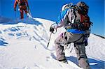 Young men mountain climbing on snowy peak Stock Photo - Royalty-Free, Artist: MonkeyBusinessImages          , Code: 400-04536310