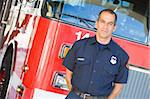 Portrait of a firefighter by a fire engine Stock Photo - Royalty-Free, Artist: MonkeyBusinessImages          , Code: 400-04536344