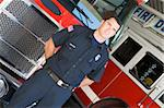 Portrait of a firefighter by a fire engine Stock Photo - Royalty-Free, Artist: MonkeyBusinessImages          , Code: 400-04536345