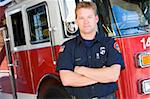 Portrait of a firefighter by a fire engine Stock Photo - Royalty-Free, Artist: MonkeyBusinessImages          , Code: 400-04536347