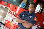Portrait of a firefighter by a fire engine Stock Photo - Royalty-Free, Artist: MonkeyBusinessImages          , Code: 400-04536349