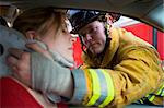 Firefighters helping an injured woman in a car Stock Photo - Royalty-Free, Artist: MonkeyBusinessImages          , Code: 400-04536365