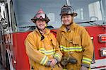 Portrait of two firefighters by a fire engine Stock Photo - Royalty-Free, Artist: MonkeyBusinessImages          , Code: 400-04536366
