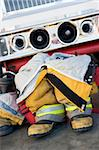 Empty firefighter's boots and uniform next to fire engine Stock Photo - Royalty-Free, Artist: MonkeyBusinessImages          , Code: 400-04536371