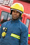 Portrait of a firefighter standing in front of a fire engine Stock Photo - Royalty-Free, Artist: MonkeyBusinessImages          , Code: 400-04536458