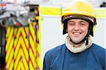 Portrait of a firefighter standing in front of a fire engine Stock Photo - Royalty-Free, Artist: MonkeyBusinessImages          , Code: 400-04536467