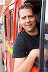 Male firefighter sitting in the cab of a fire engine Stock Photo - Royalty-Free, Artist: MonkeyBusinessImages          , Code: 400-04536475