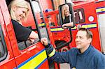 Firefighter sitting in the cab of a fire engine talking to a co- Stock Photo - Royalty-Free, Artist: MonkeyBusinessImages          , Code: 400-04536480