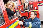 Firefighter sitting in the cab of a fire engine talking to a co- Stock Photo - Royalty-Free, Artist: MonkeyBusinessImages          , Code: 400-04536482