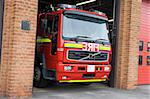 A fire engine leaving the fire station Stock Photo - Royalty-Free, Artist: MonkeyBusinessImages          , Code: 400-04536490