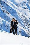 Businessman outdoors on snowy mountain using cellular phone Stock Photo - Royalty-Free, Artist: MonkeyBusinessImages          , Code: 400-04539415