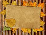 Japanese reed mat, paper sheet and autumn leafs