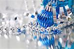 A lovely blue baubles on a mirror  surface with ribbons and beads. Stock Photo - Royalty-Free, Artist: sundikova                     , Code: 400-04545029
