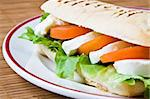 Lettuce, tomato and mozzarella in a fresh panini Stock Photo - Royalty-Free, Artist: Raphotography                 , Code: 400-04546141